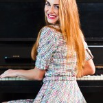 woman with long hair plays the piano